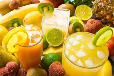 group of three juices with colorful fruits