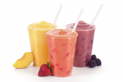 three flavors of smoothies: peach, strawberry, and blackberry in generic cups with straws and fruit garnishes